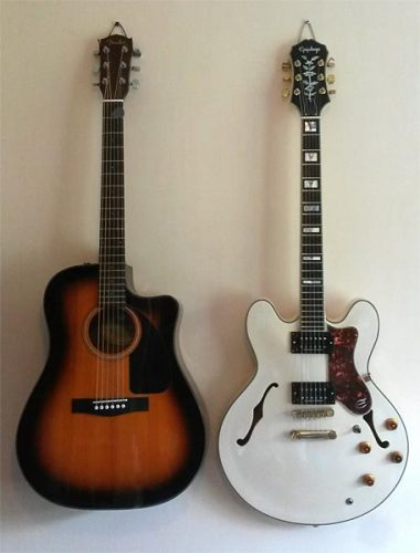 Acoustic guitar on the left, electric guitar on the right