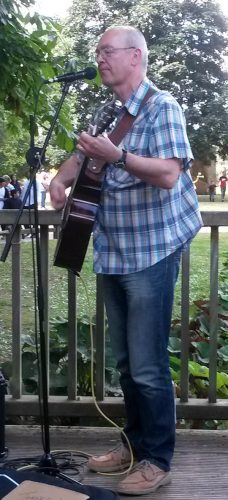 Graham Armfield busking at Woking Party in the Park 2015